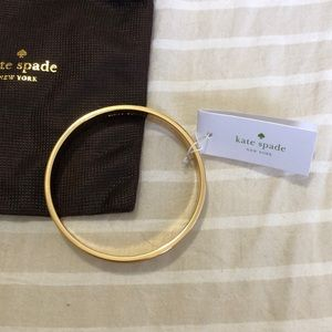 kate spade Jewelry - NWT Kate Spade white and gold spade bangle